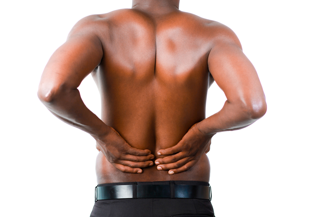 man has lower back pain in Omaha, NE