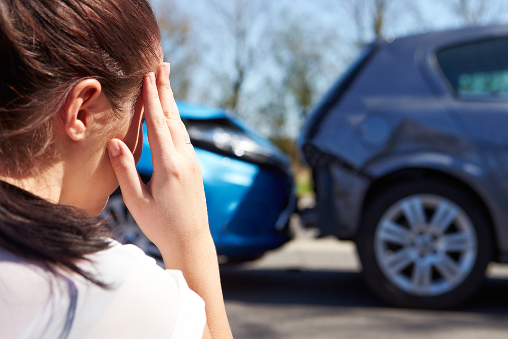 women has a headache from a car accident