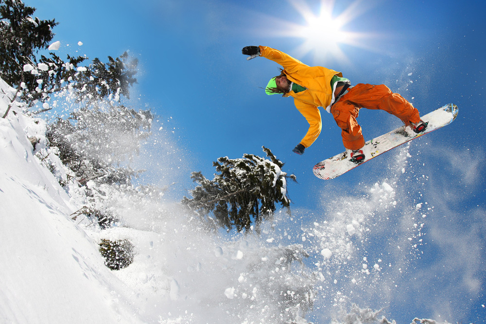 man on snowboard taking air