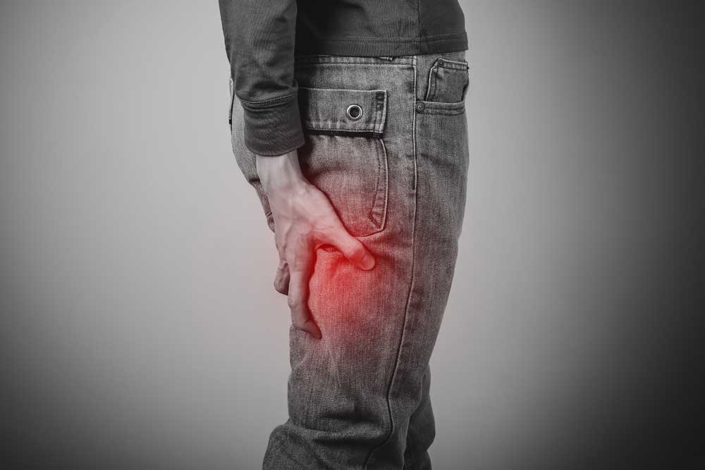 Man with sciatica pain needs chiropractic care.
